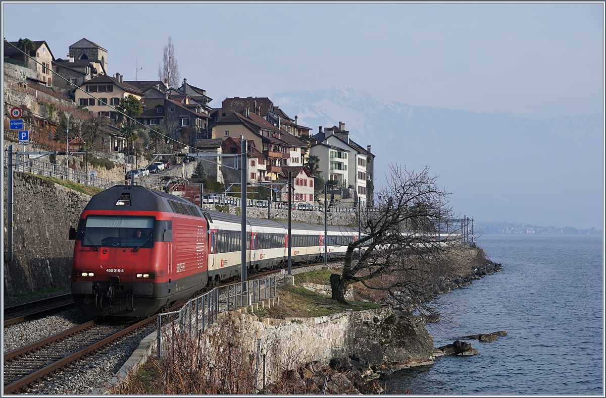The SBB Re 460 018-5 with an IR to Geneva Airport by St Saphorin. 06.02.2018