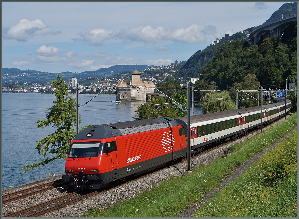 The SBB Re 460 036-7 with an IR to Brig by the Castle of Chillon. 