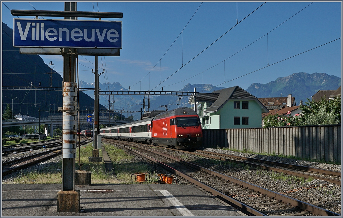 The SBB Re 460 044-9 with an IR to Geneva Airport in Villeneuve. 