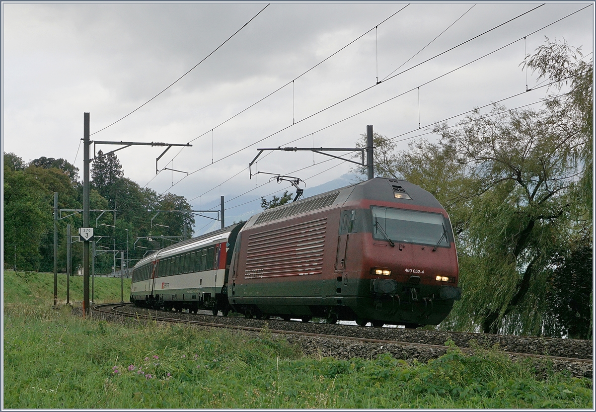 The SBB Re 460 052-4 with an IR by Villenveuve.
