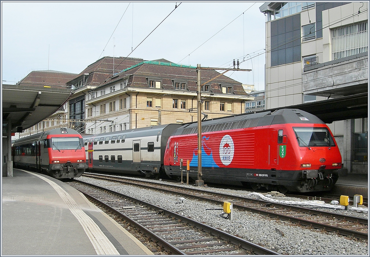 The SBB Re 460 058-1  100 years Circus Knie  with his IC1 713 in Lausanne.
