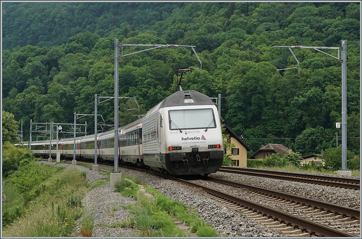 The SBB Re 460 071-4  Helvetia  with a IR 90 on the way to Brig by St-Maurice. 