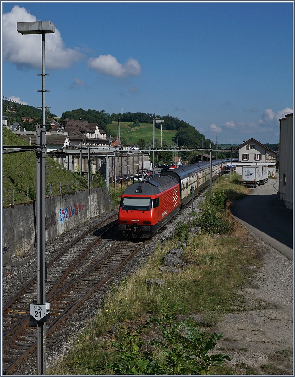 The SBB Re 460 097-9 with an IR to Basel in Läufelfingen. 