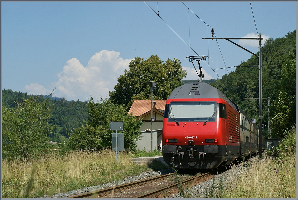 The SBB Re 460 097-9 with an IR in Rümlingen (Alte Hauenstein Line).