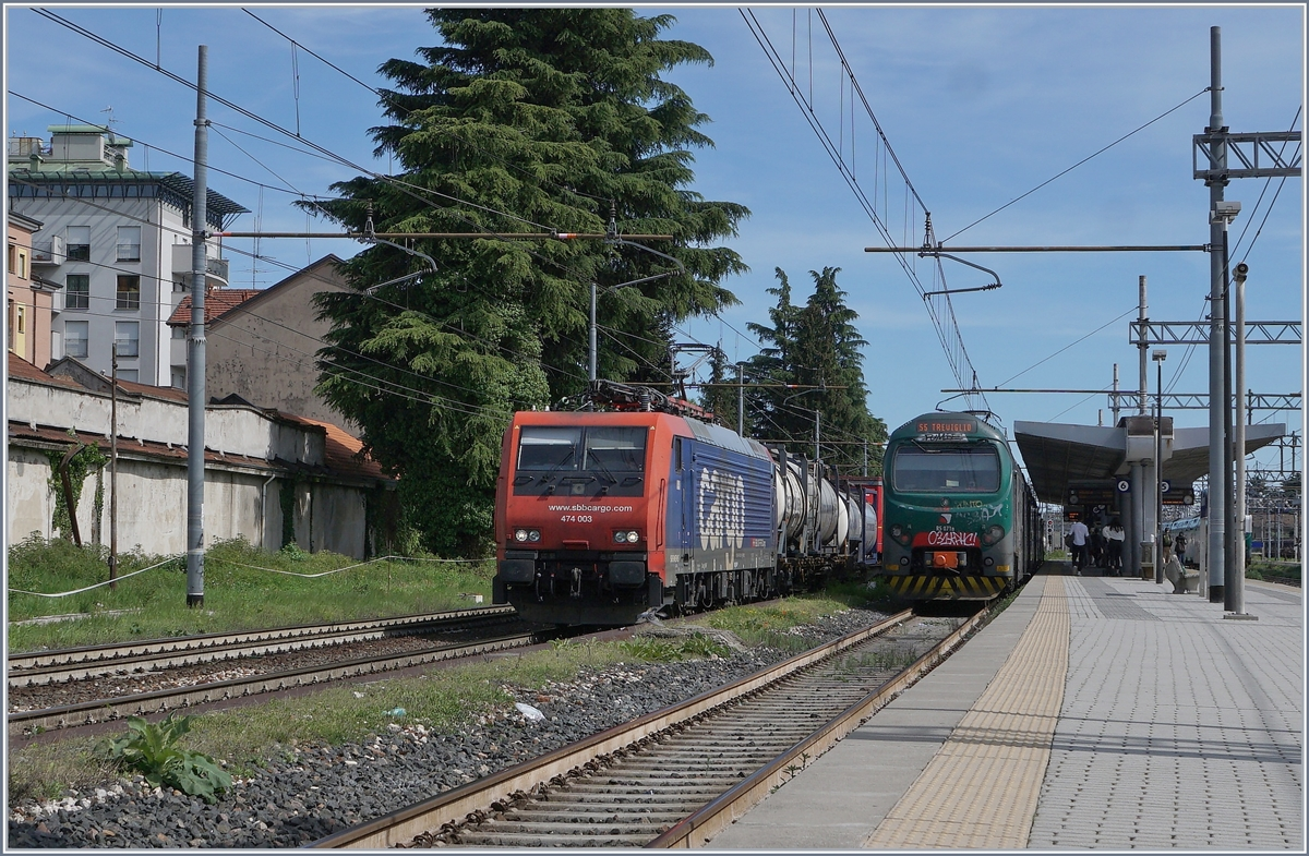 The SBB Re 474 003 and a Trenord Ale 711 in Gallarate.