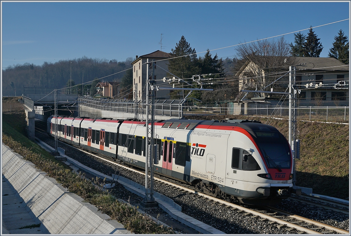 The SBB Tilo Flirt RABe 524 008  Mendrisiotto  on the way to Malpensa is arriving at Cantello Gaggiolo.