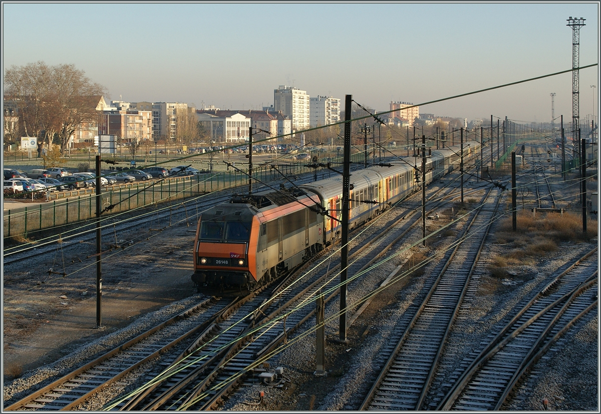 The SNCF BB 26 148 with a TER 200 is arriving at Mulhouse.