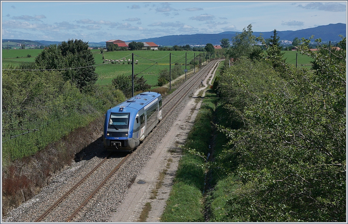 The SNCF X 73758 on the way to Frasne near La Rivière-Drugeon.
