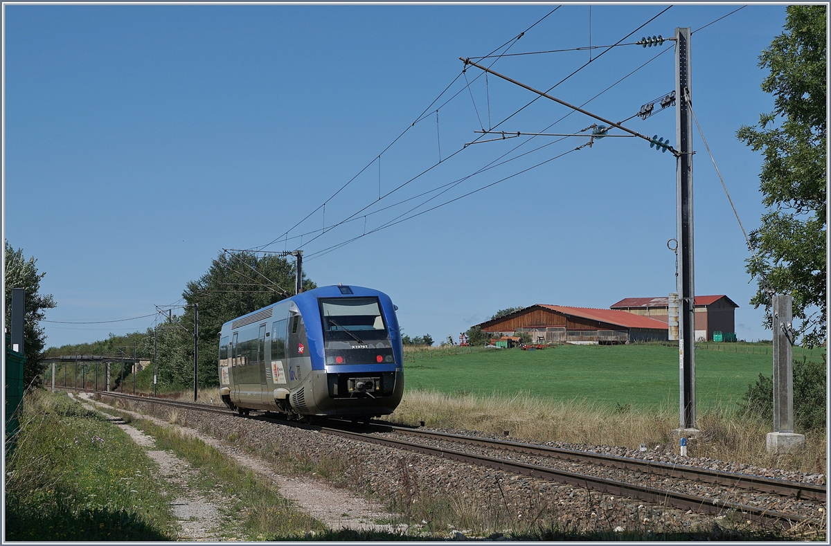 The SNCF X 73767 on the way to Frasne by La Rivière - Drugeon.