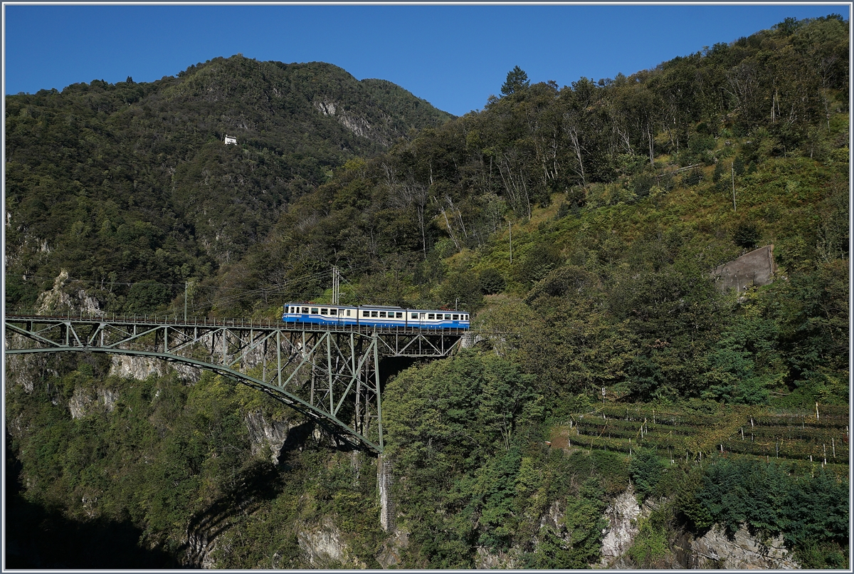 The SSIF ABe 8/8 N° 22  Ticino  on the way from Locarno to Domodossola on the Isorno Bridge by Intragna. 10.10.2019