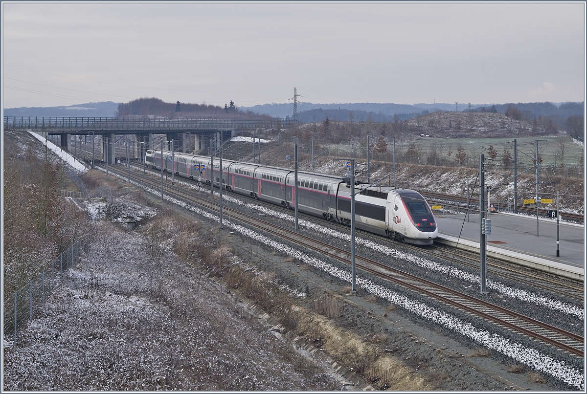 The TGV 6704 from Mulhouse to Paris is leaving the Belfort-Montbéliard-TGV Station.