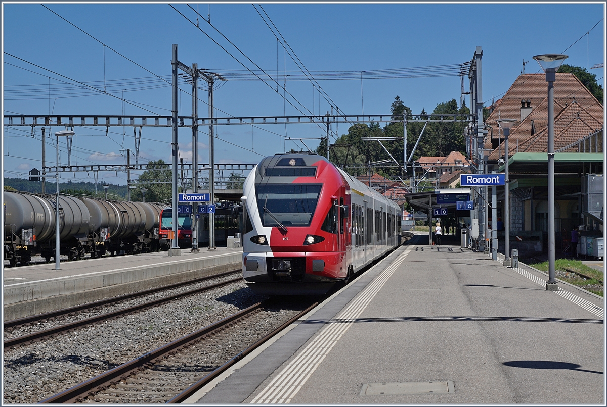 The TPF Flirt N° 197 in Romont. This train is the Bern - Bulle Service wiht the Number 3822.