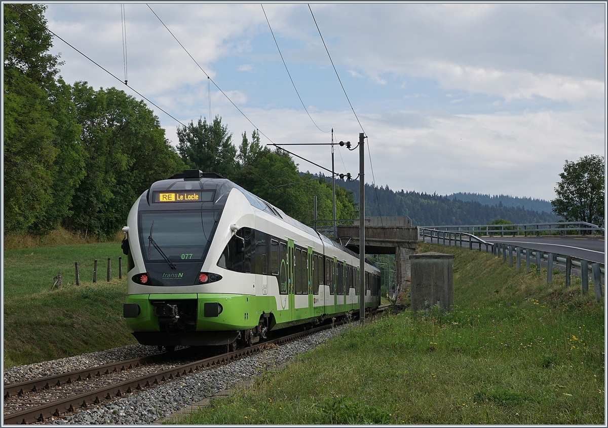 The TransN RABe 523 077 on the way to Le Locle by Les Haut-Geneveys. 