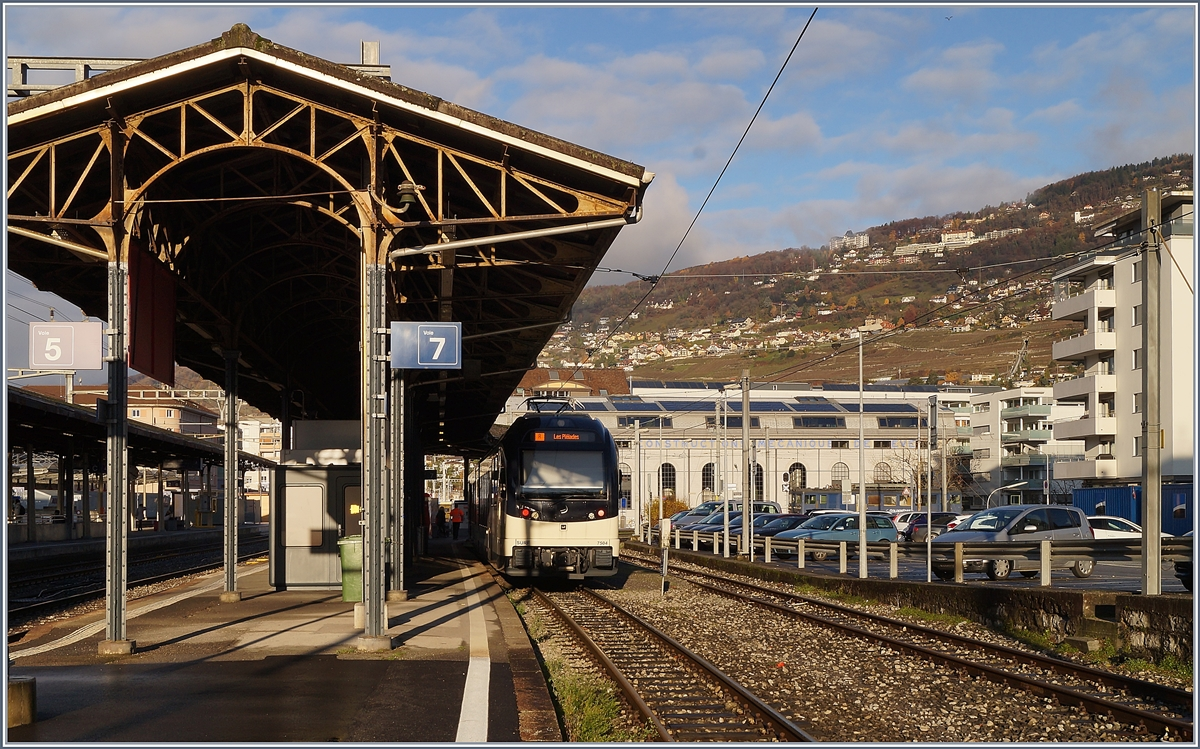 The Vevey station with CEV MVR ABeh 2/6 and in the Background the old  Atelier de Construction de Vevey . 