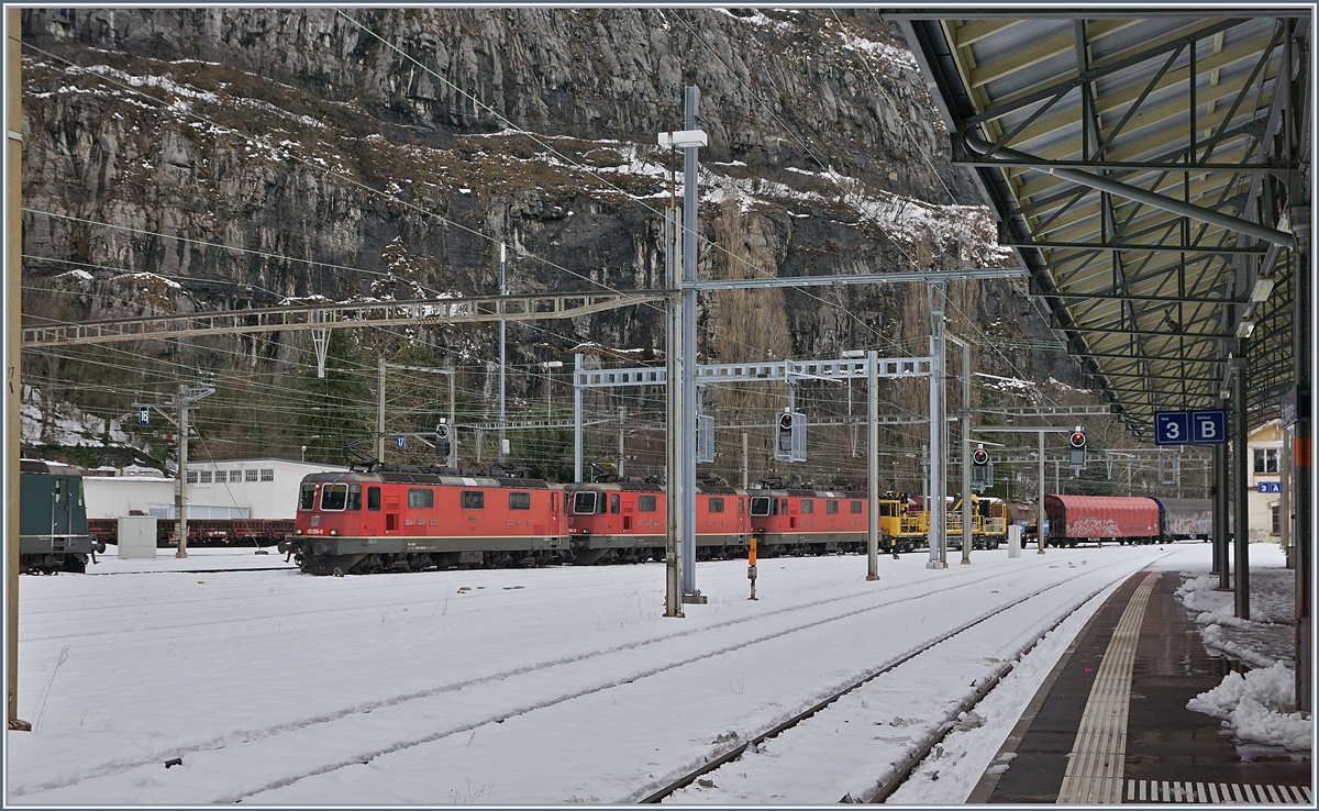 Three SBB RE4/4 II with a Cargo train are arriving at the St Maurice Station. 