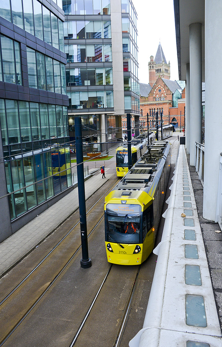 Tram 3019 (left) passing Tram 3110 (right) on the line between Piccadilly Gardens and Piccadilly Station.