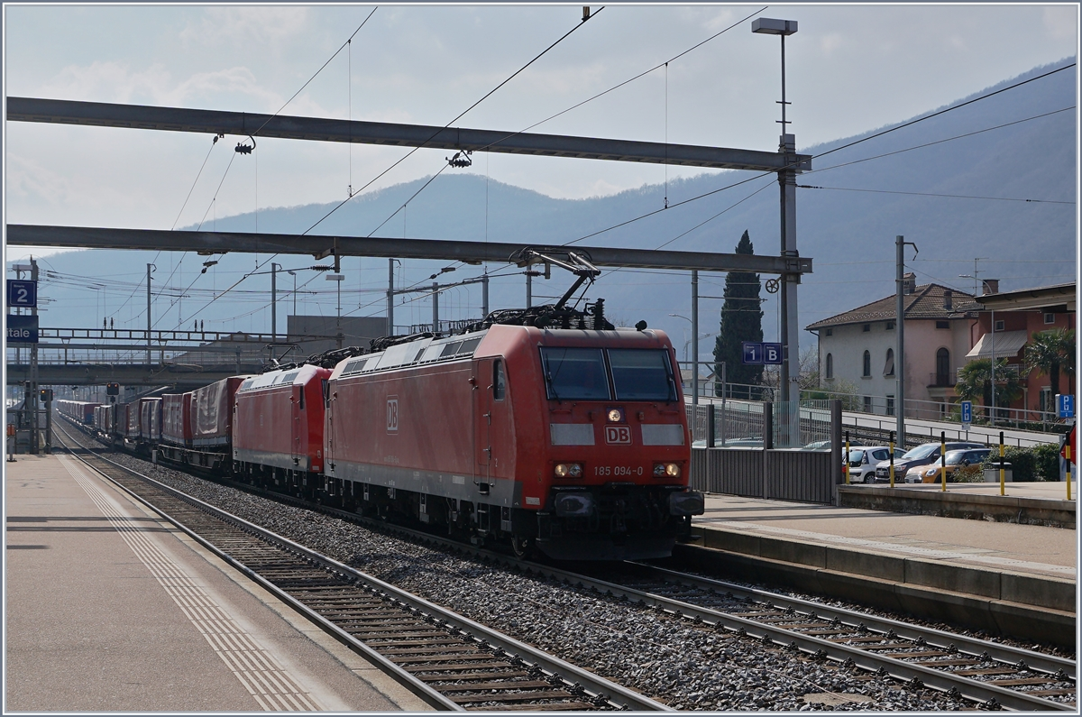 Two DB 185 with a long Cargo Train on the way to Bellinzona in Capolago Riva San Vitale.