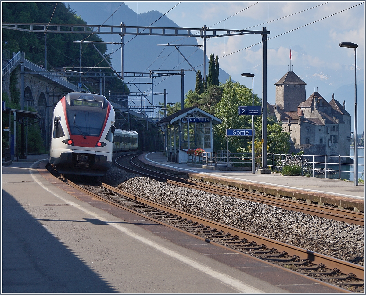 Two SBB RABe 523 are stoping at the Veytaux-Chillon Station.