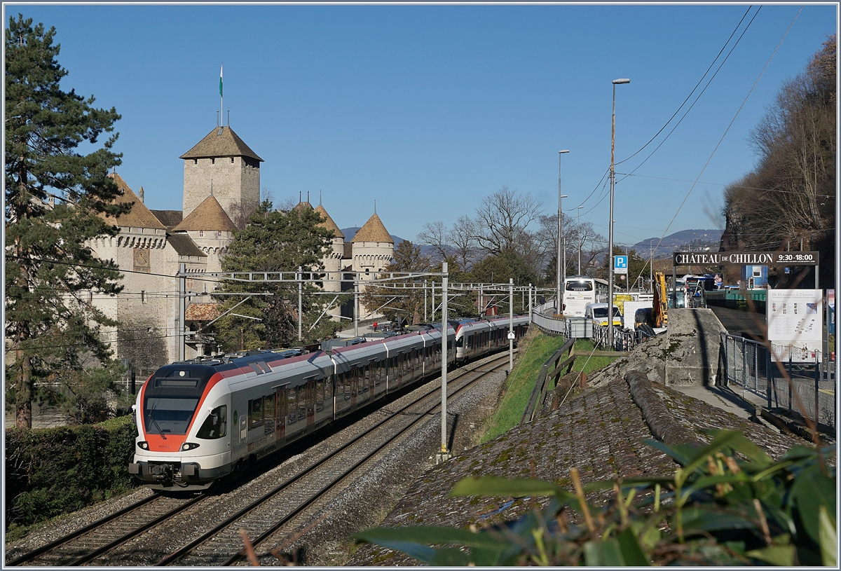 Two SBBB RABe 523 (FLIRT) on the way to Lausanne by the Castle of Chillon.