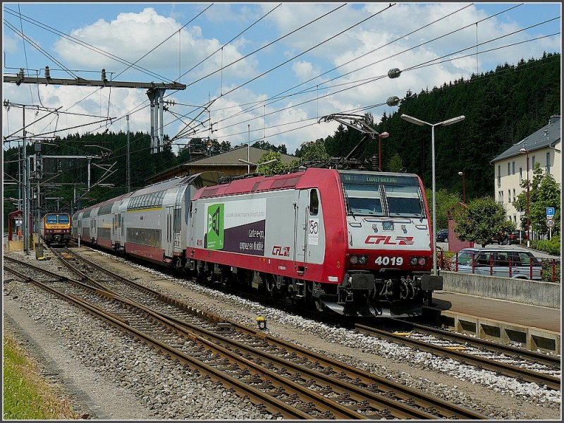 4019 with bilevel cars is leaving the station of Troisvierges on June 1st, 2009.