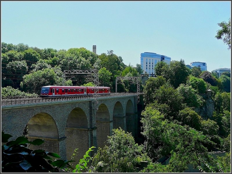 The train to Trier (D) has left the station of Luxemboug City a few minutes ago and crosses now the  Bisserweg  bridge August 1st, 2009.