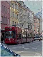 Tram 315 is running through the Museumsstraße at Innsbruck on December 22nd, 2009.