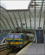 The HLE 2119 with M 4 cars is leaving the station Liège Guillemins on June 25th, 2012.
