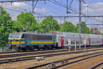 On 10 June 2015 NMBS 2135 pushes M5-stock out of Antwerpen-Berchem toward Antwerpen Centraal and Essen (BE).