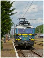 HLE 2365 is running through the station of Erquelinnes on June 23rd, 2012.