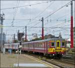 The AM 62 196 togehter with a AM City Rail is entering into the station Bruxelles Midi on June 22nd, 2012.