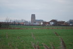 L-train Zeebrugge-Brugge passing Lissewege church in January 2014.