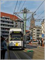 De Kusttram N° 6027 is arriving at the stop Blankenberge Station on November 12th, 2011.