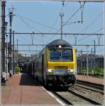 A push-pull train headed by a M6 control car is entering into the station of Hasselt on June 23rd, 2010.
