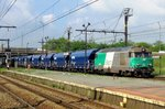 Cereals train with 67494 speeds through Antwerpen-Luchtbal on 29 August 2013.