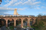 TER Rodez-Toulouse passing Ste-Cécile cathedral over the Castelviel bridge in Albi on 20th March 2016.
