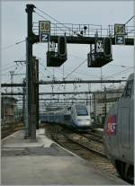 A TGV Duplex is leving Paris Gare de Lyon.
