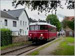 The RSE MAN railcar VT 23 is arriving at the stop Olef on the Oleftalbahn on August 28th, 2011.