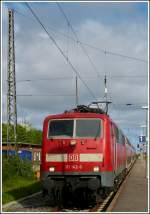 111 142-6 with bilevel cars pictured in Norddeich on May 13th, 2012