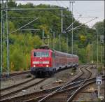 111 080 is hauling the RE 9 (Rhein-Sieg-Express) into the station of Betzdorf (Sieg) on October 13th, 2012.