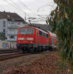 After shot: 111 080-8 on 11.12.2011 pushes the RE 9 (Rhein-Sieg-Express)  Siegen-Cologne-Aachen in the station Betzdorf/Sieg, then it goes in the direction of Cologne - Aachen.