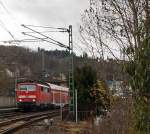 111077-4 with RE 9 (Rhein-Sieg-Express) Aachen - Cologne - Siegen, on 10.12.2011, leaving here the station  Betzdorf/Sieg and continue towards Siegen.