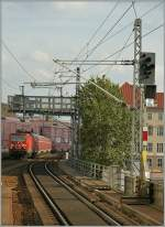 A DB 143 with a local train is arriving at Berlin Alexander Platz. 