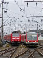 RE 5 to Emmerich and RB 38 to Köln Deutz are entering together into the main station of Cologne on December 22nd, 2012.