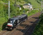 . MRCE ES 64 U2-098 (182 598-3) is running alone through Kattenes on the Mosel track on June 22nd, 2014.