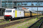 PCT Altmann car carrying train with 185 637 at the reins passes slowly through Regensburg Hbf on 15 May 2012.