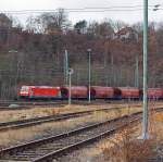 185 402-5 (TRAXX F140 AC2) of DB Schenker Rail Danmark Services A / S - Denmark (A joint venture of DB Schenker Rail Cargo and Green) with grain silo wagons Tagnoos 898 complete train, runs on