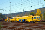 STRABAG  Tauberexxpress  a Plasser & Theurer Track Tamping Machine CSM 09 – 3X (PL), standing on 23.10.2016 in Betzdorf/Sieg (Germany).