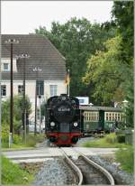 Will bee arriving in a few moment in Baabe:  RüBB 994011-5 with a local train to Binz LB.
