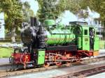 Mh Steam Locomotive 53 ,( 99 4633-6 ) in green livery , is on the island of Rügen in use.