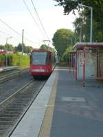 A tram (Line 18 to Buchheim) is leaving the station  Efferen .